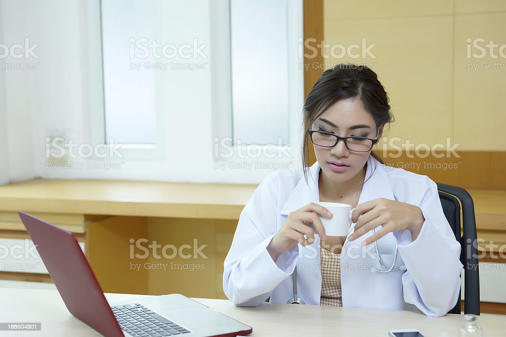 Female doctor had a very exhausting day at work royalty-free stock photo