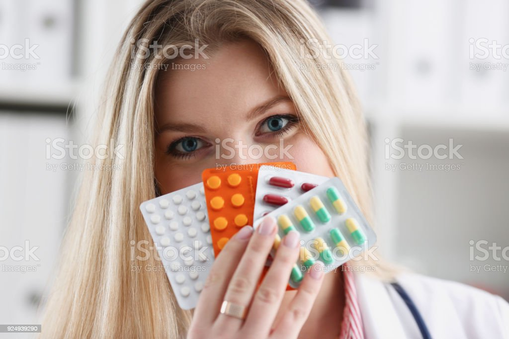 Female doctor hand holding pack of different stock photo