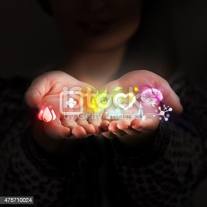 istock Female doctor hand holds virtual medical icons as medical concept 475710024