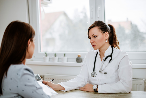 Female Doctor Having Serious Conversation With Patient -8598