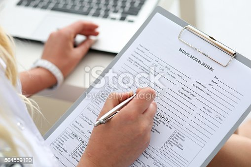 istock Female doctor hold clipboard pad 564559120