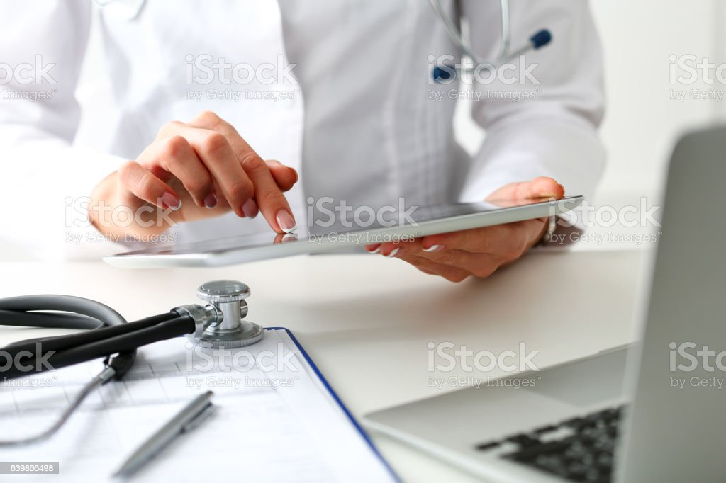 Female doctor hold digital tablet pc stock photo