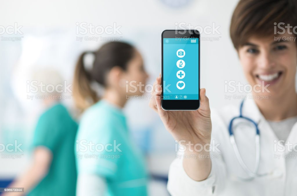 Female doctor holding a smartphone stock photo