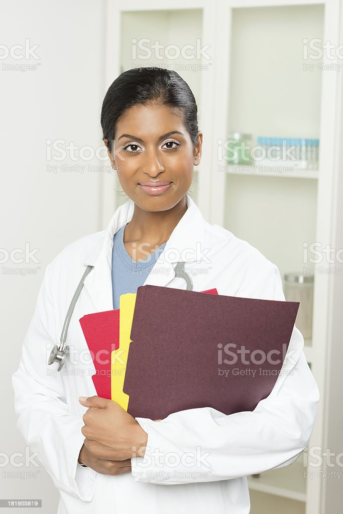 Female Doctor Holding Folders royalty-free stock photo