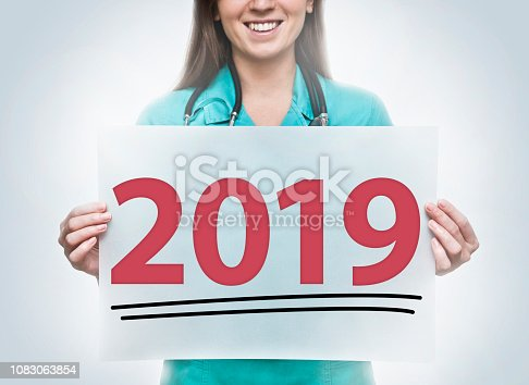 HAPPY NEW YEAR  2019 /  Female doctor holding paper with text (Click for more)
