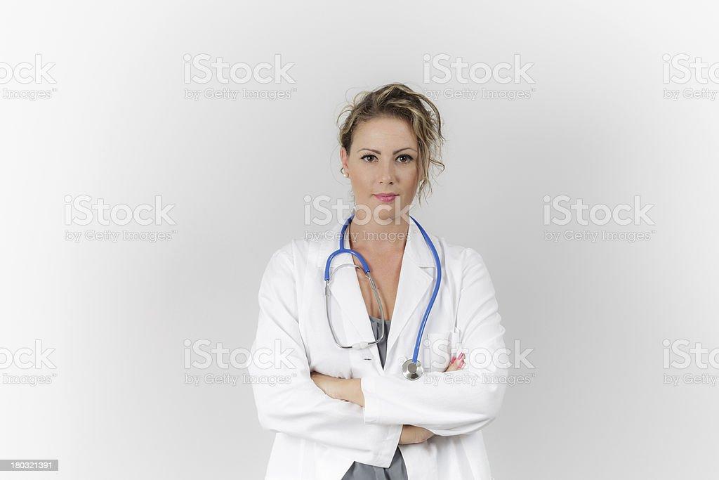 Female doctor holding stethoscope royalty-free stock photo