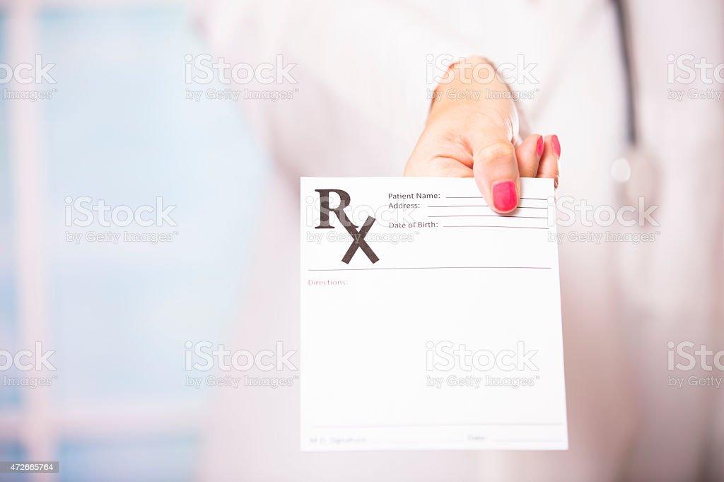 Female doctor holds blank prescription document. Hospital, clinic. stock photo