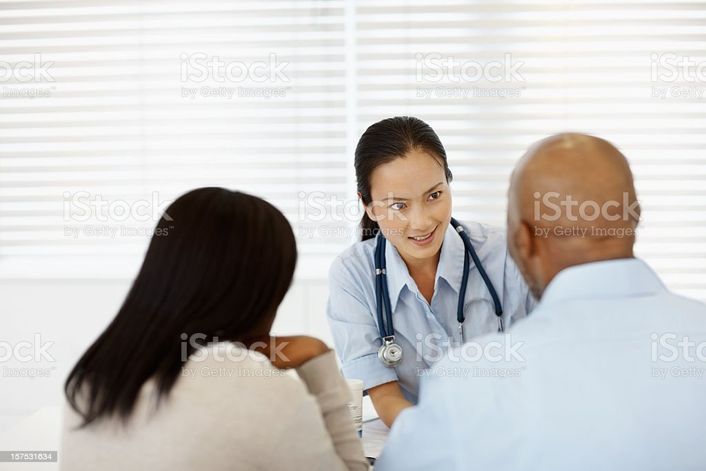 Female doctor in a meeting with couple royalty-free stock photo