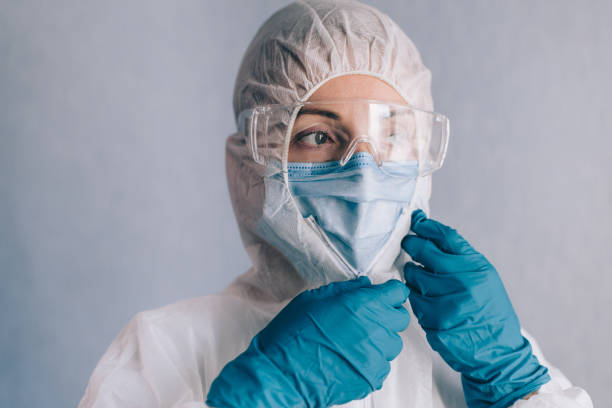 Female doctor in a protective suit. stock photo
