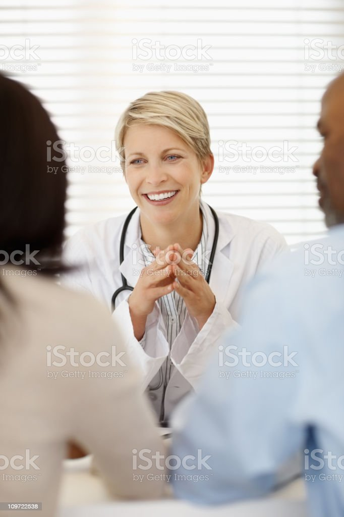 Female doctor in discussion with a couple royalty-free stock photo