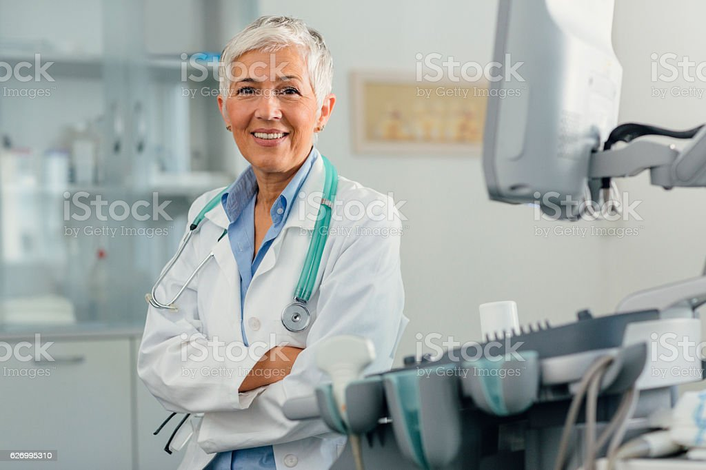 Female Doctor In Her Office. stock photo