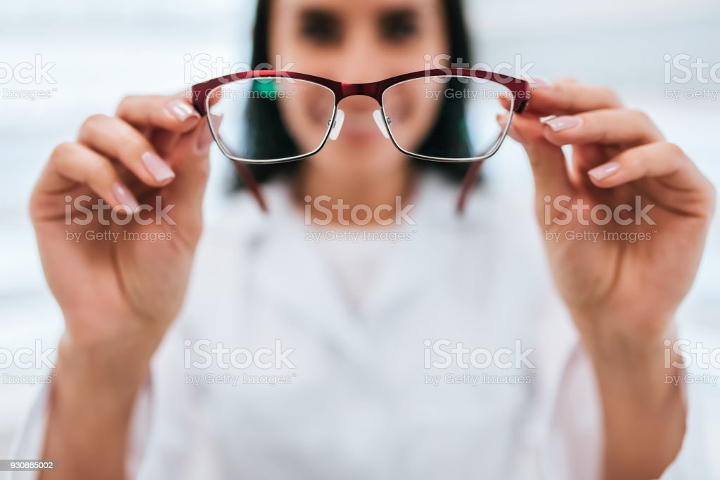 Female doctor in ophthalmology clinic stock photo
