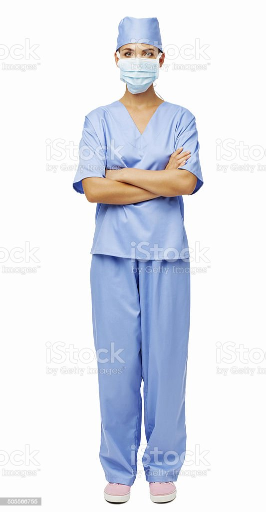 Female Doctor In Scrubs Standing Arms Crossed stock photo