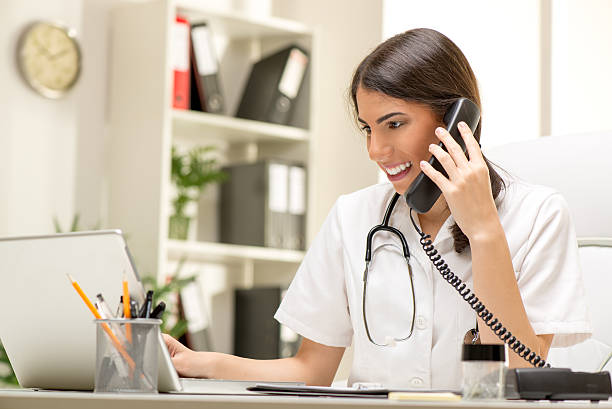 female doctor in the office - nurse on phone stock photos and pictures