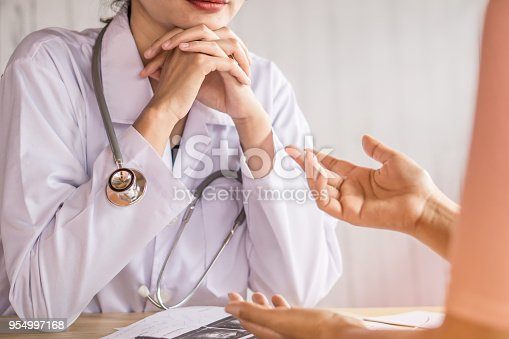 istock female doctor listening to depressed patient talking at hospital 954997168