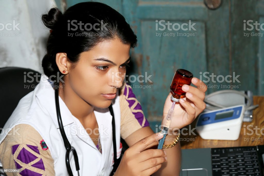 Female doctor preparing injection in clinic stock photo