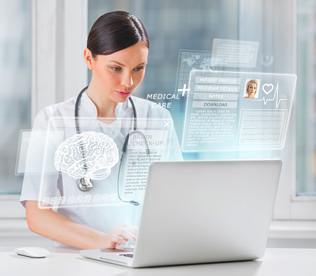 Female doctor scanning brain of patient with help of modern technology