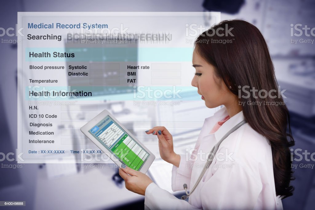 Female doctor searching patient information. - foto de acervo