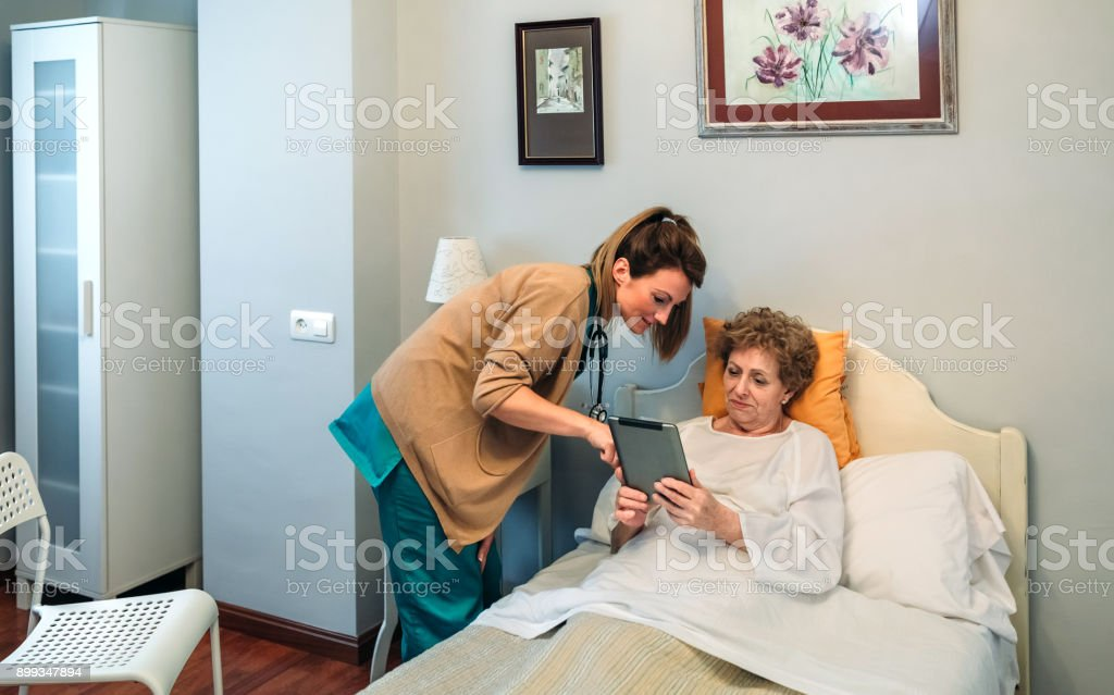 Female doctor showing results of a medical test on the tablet stock photo