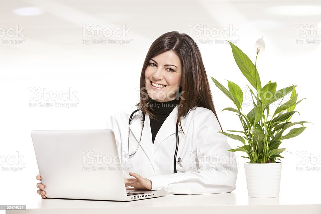 Female doctor sitting at her desk royalty-free stock photo
