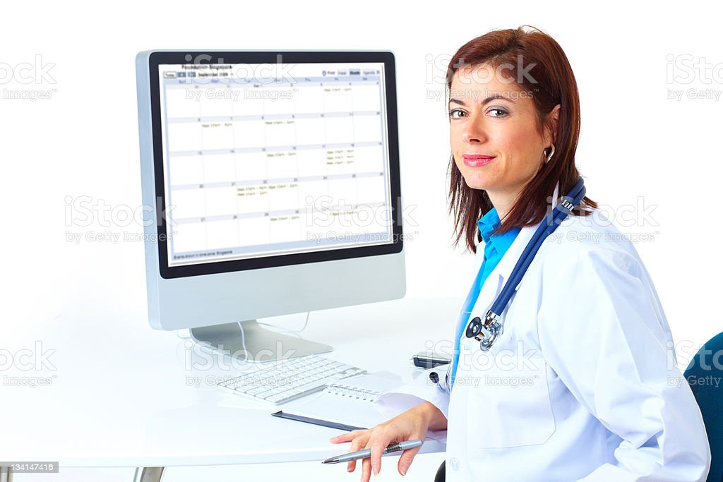 Female doctor sitting in front of computer screen royalty-free stock photo