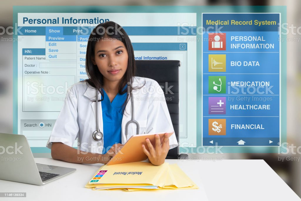 Female doctor sitting in office with electronic medical record screen...