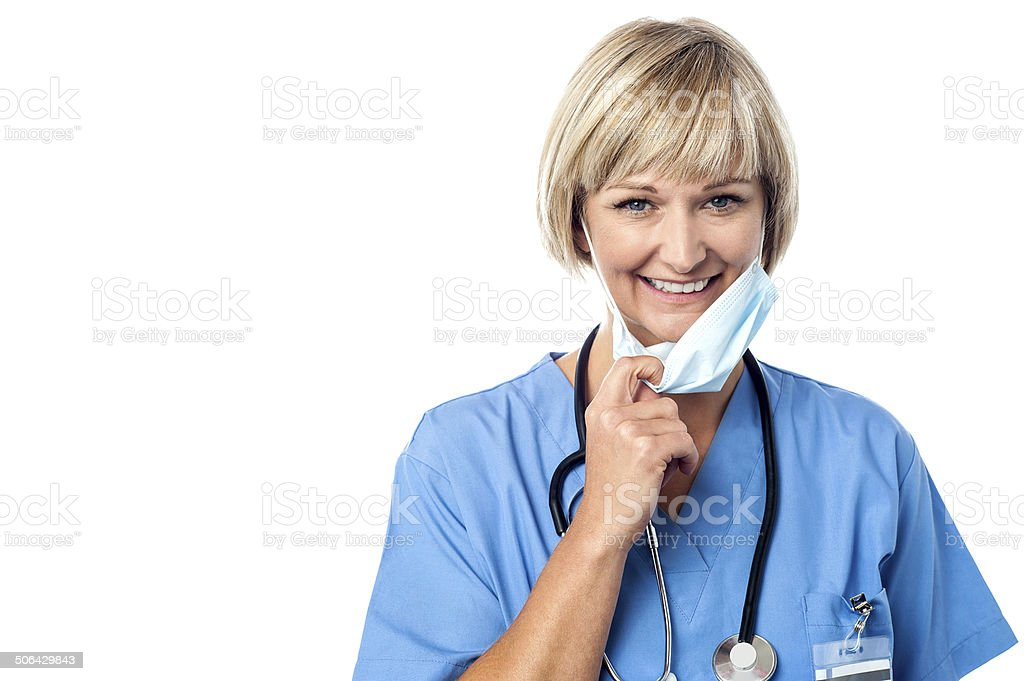 Female doctor takes off his mask stock photo