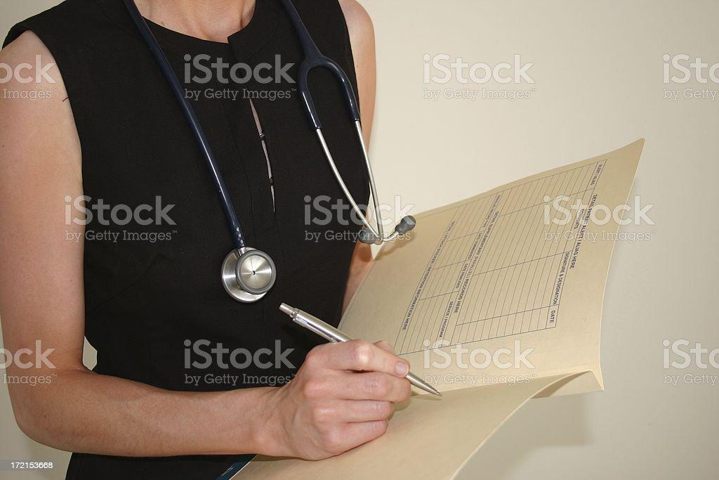 female doctor taking medical history royalty-free stock photo