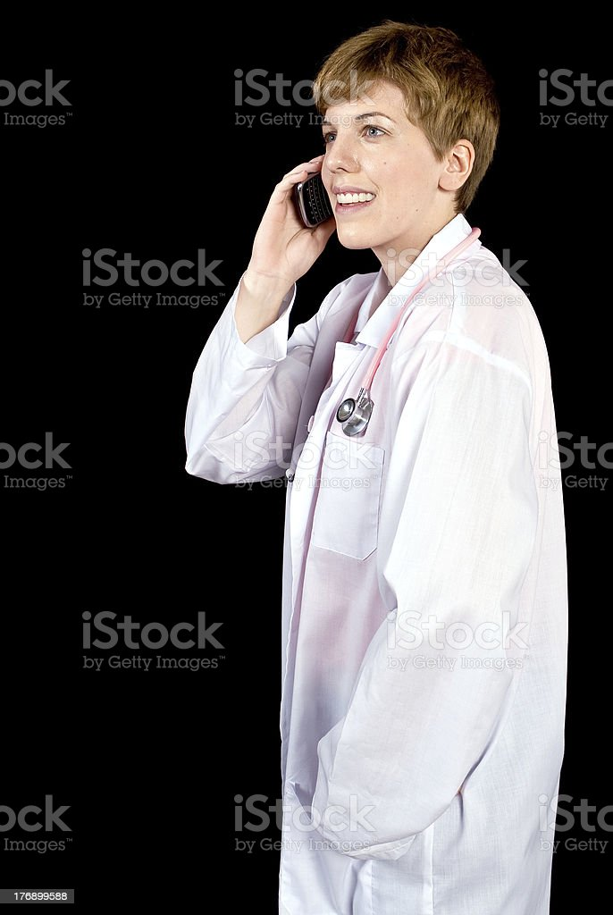 Female doctor talking on a cell phone royalty-free stock photo