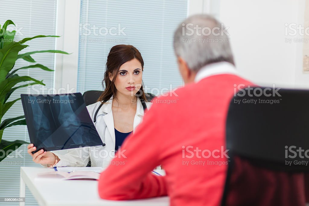 Female doctor talking to patient royalty-free stock photo
