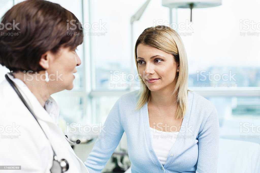 Female doctor talking with patient stock photo