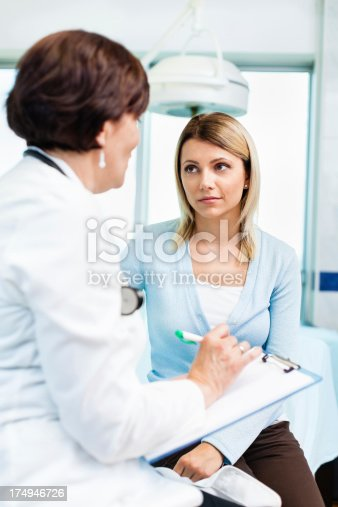 479964946istockphoto Female doctor talking with patient 174946726