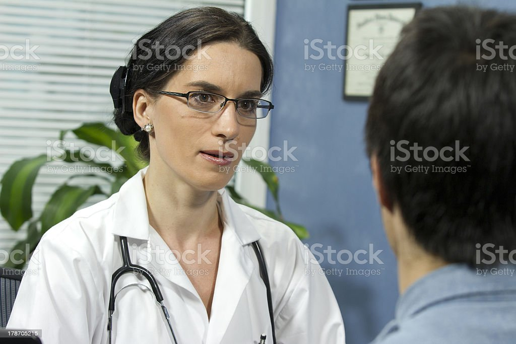 Female doctor talking with patient royalty-free stock photo