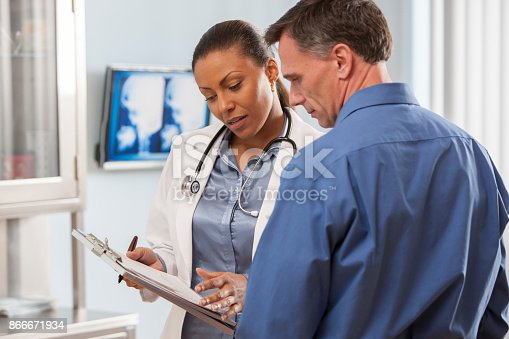 istock Female doctor talking with patient. 866671934