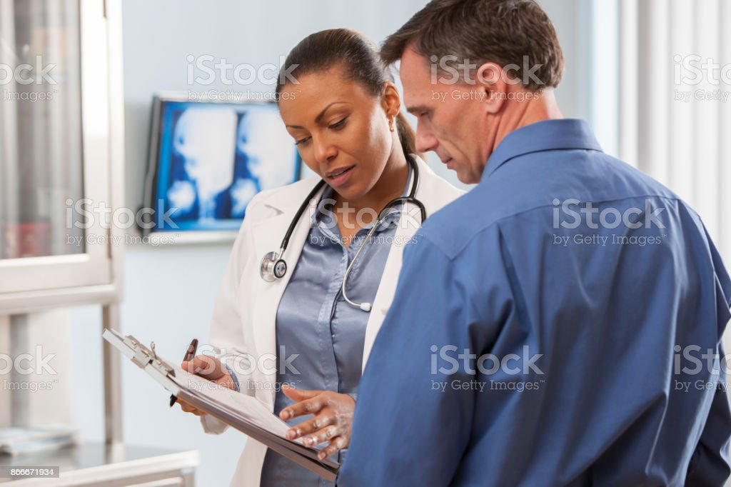 Female doctor talking with patient. stock photo