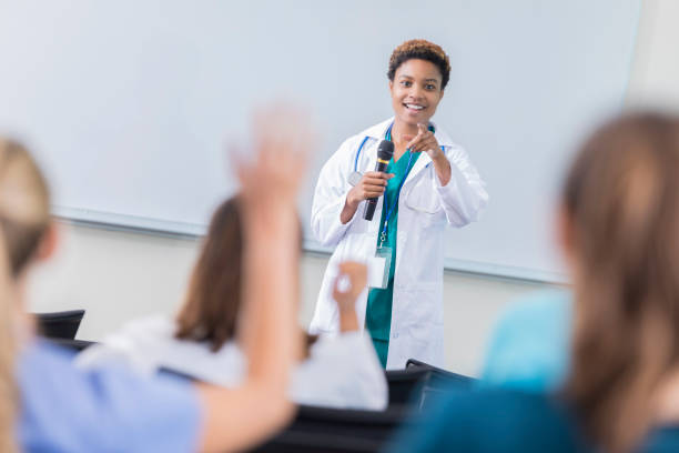 Female doctor teaches a class at medical school stock photo