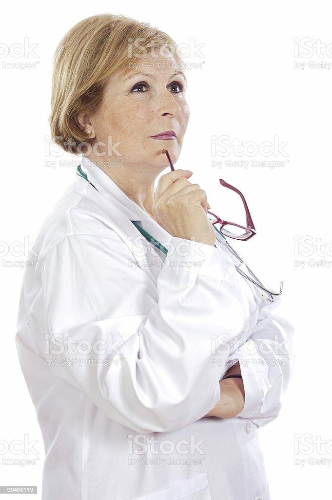 Female doctor thinking royalty-free stock photo
