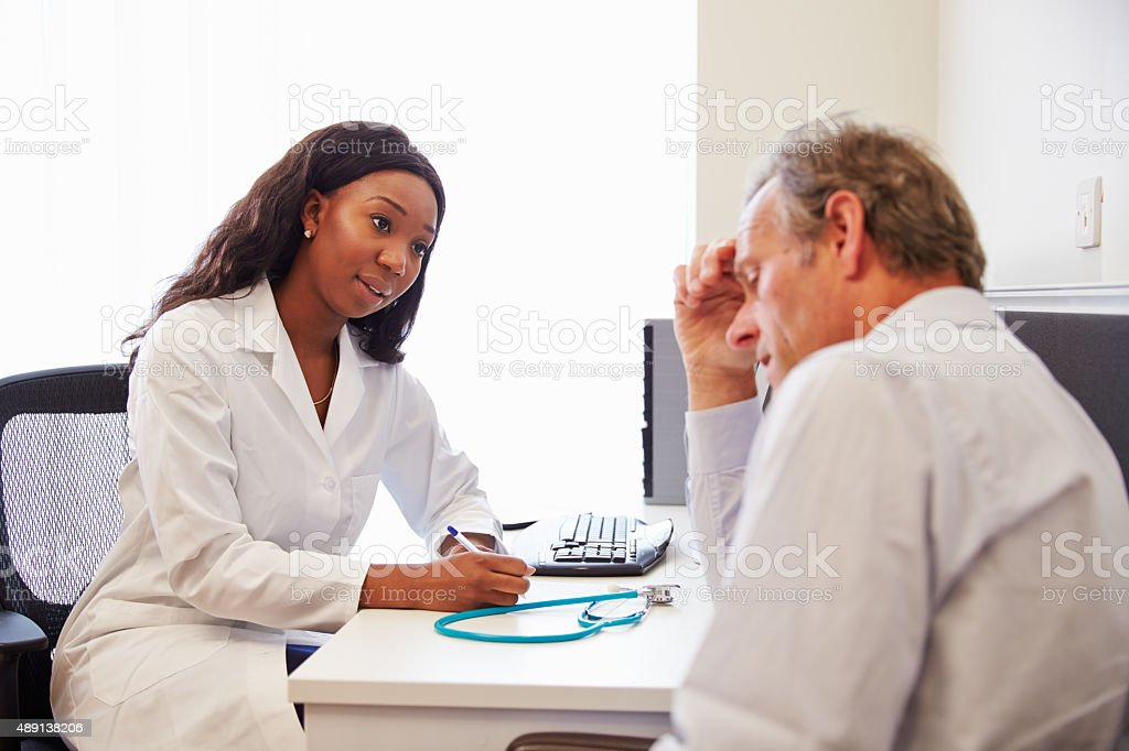Female Doctor Treating Patient Suffering With Depression stock photo
