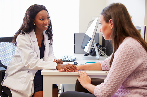 Female Doctor Treating Patient Suffering With Depression Stock Photo - Download Image Now