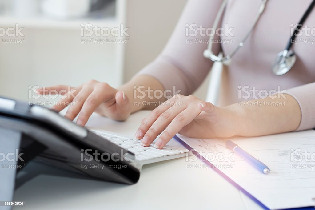Female doctor using a digital tablet stock photo