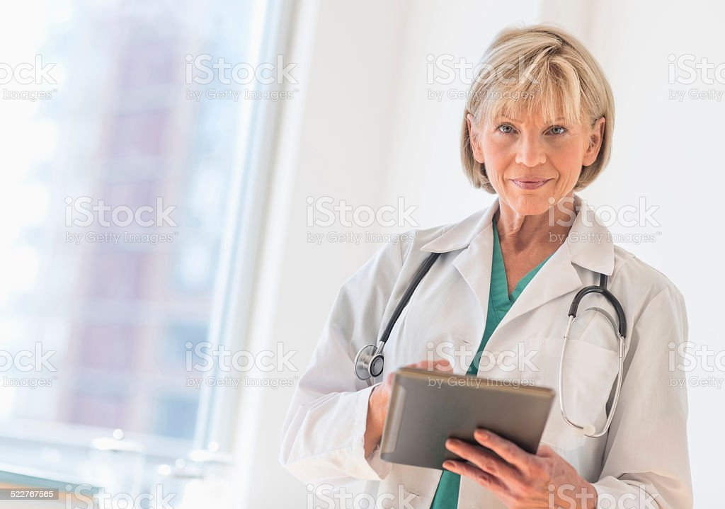 Female Doctor Using Digital Tablet In Hospital stock photo