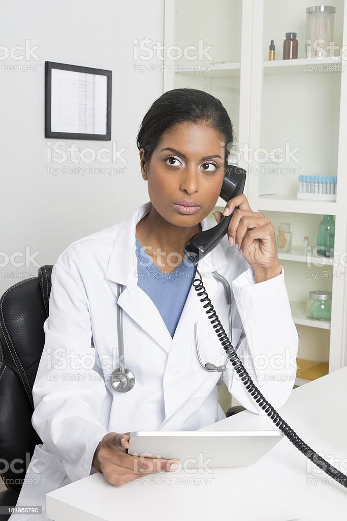 Female Doctor Using Telephone royalty-free stock photo