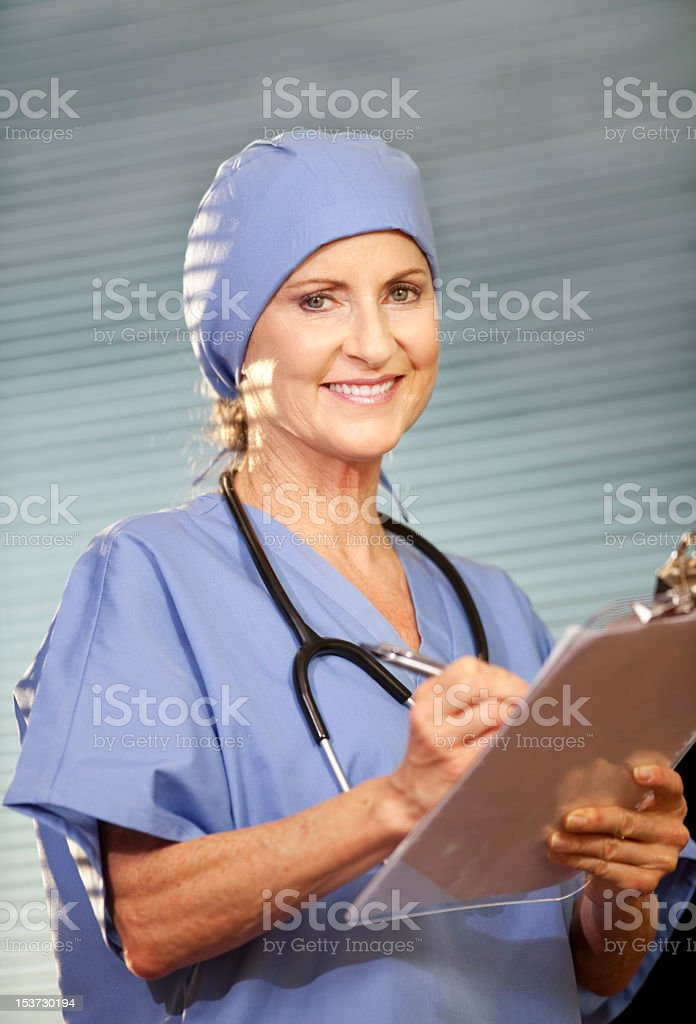 2889d208ca9 Female Doctor Wearing Scrubs And Surgical Cap Stock Photo & More ...