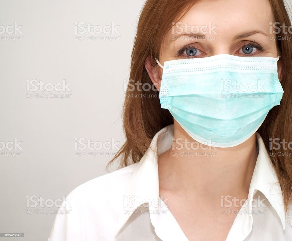 Female doctor with a facemask on stock photo