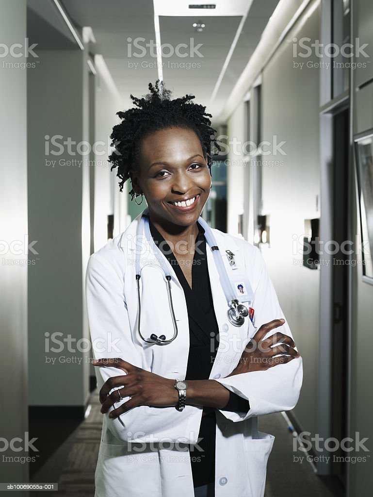 Female doctor with arms crossed smiling, portrait royalty-free stock photo