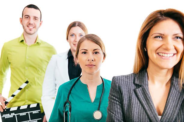 female doctor with businesswomen, lawyer and artist in teamwork - four lawyers stockfoto's en -beelden