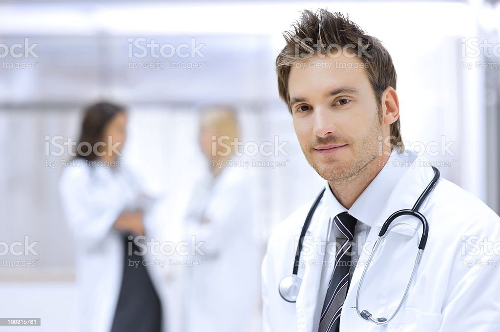 Female doctor with colleagues in the background royalty-free stock photo