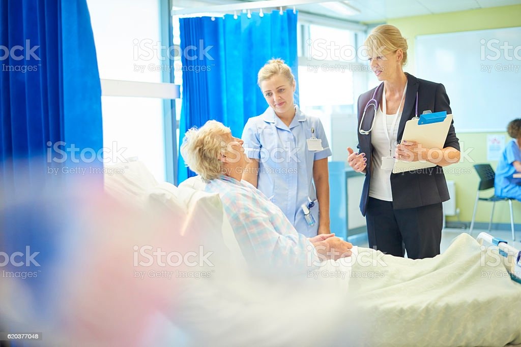 female doctor with hospital patient stock photo