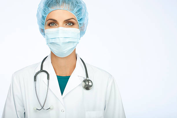 Female Doctor With Mask And Stethoscope stock photo