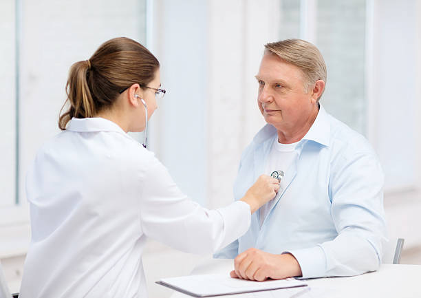 female doctor with old man listening to heart beat healthcare, medicine and elderly concept - female doctor or nurse with old man listening to heart beat human lung stock pictures, royalty-free photos & images